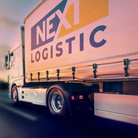 Nextlogistic Truck on a highway sunset