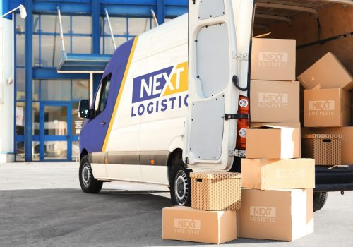 Branded bus fully loaded of packages with nextlogistic logo on them