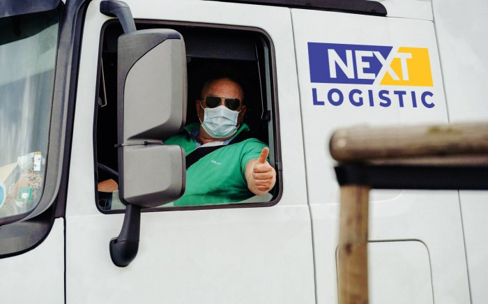 truck driver with a protective mask showing a thumb up