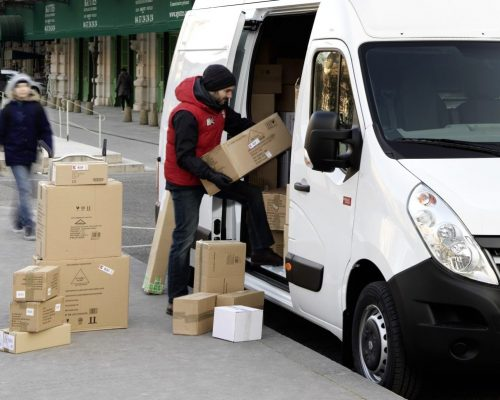 Loading packages in a van on a city street